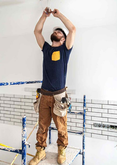 electrician-builder-at-work-installation-of-lamps-52CY9UP.jpg